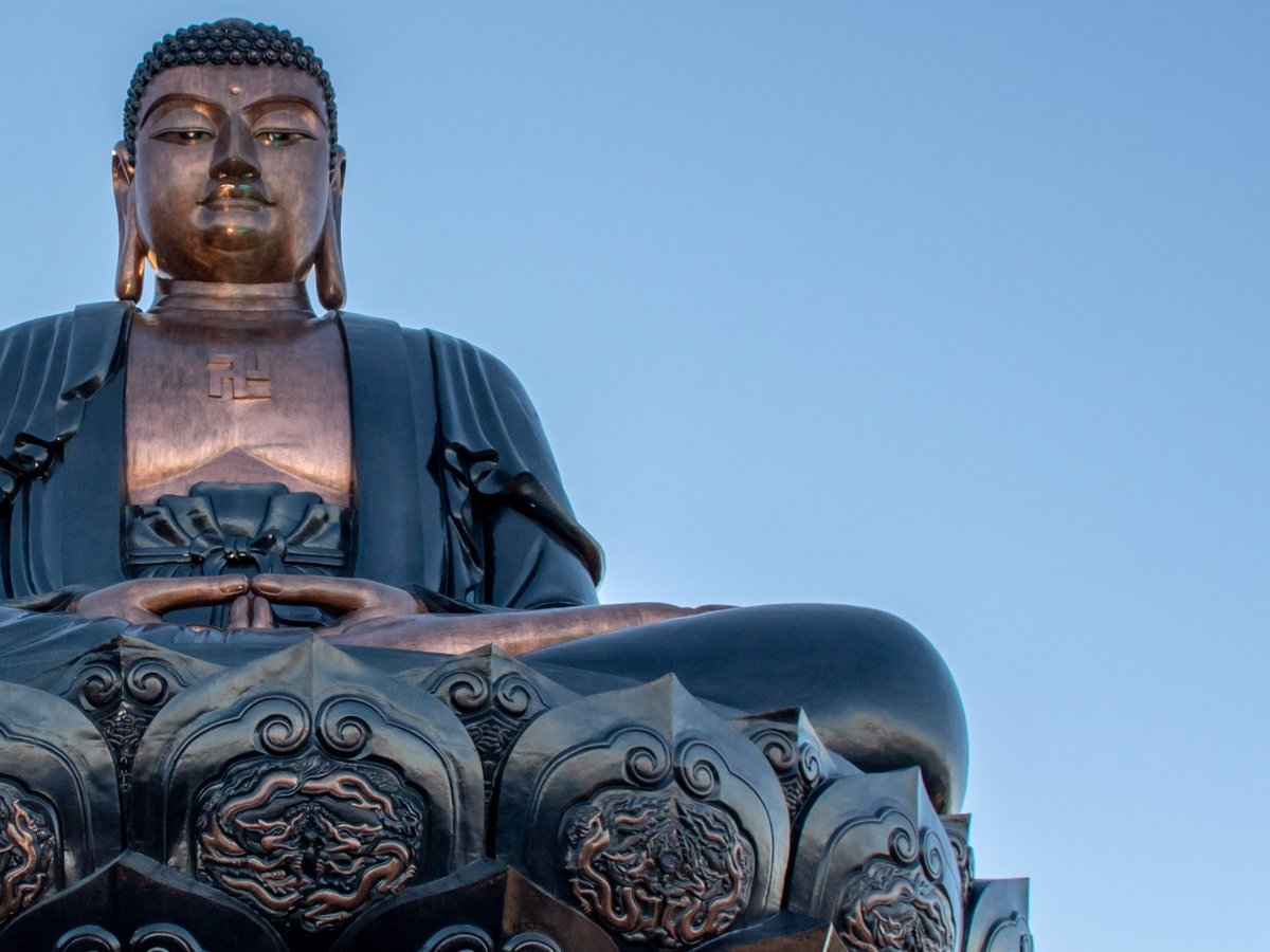 Bronze Buddha Statue with blue sky