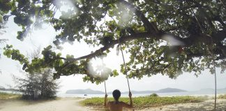 tropical-beach-woman-on-a-swing