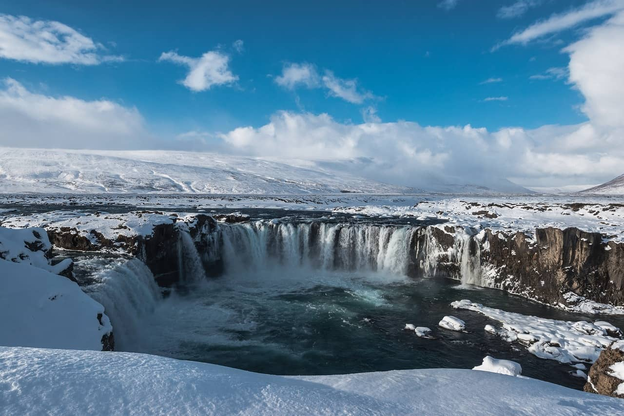 Icy waterfalls surrounded by snowy landscapes