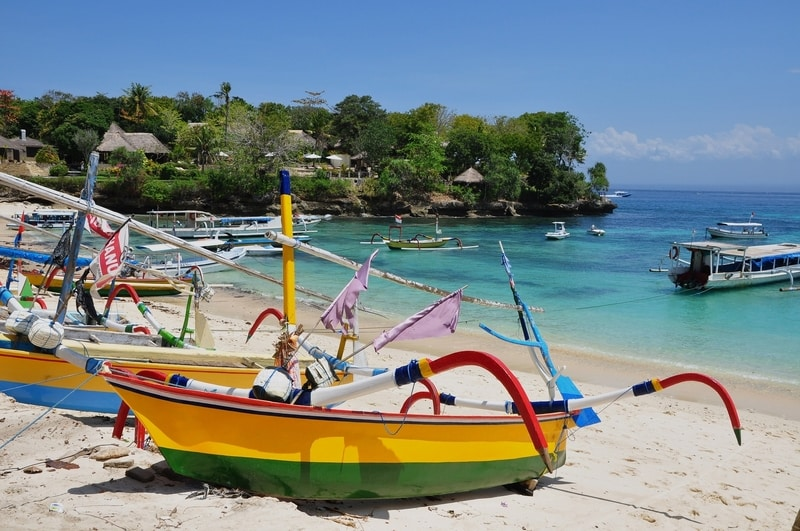 Boats docked on white sandy beaches of Bali