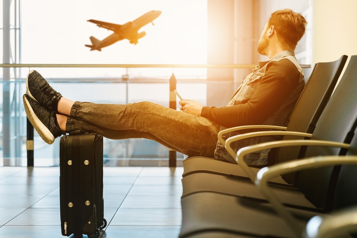 student sitting at airport