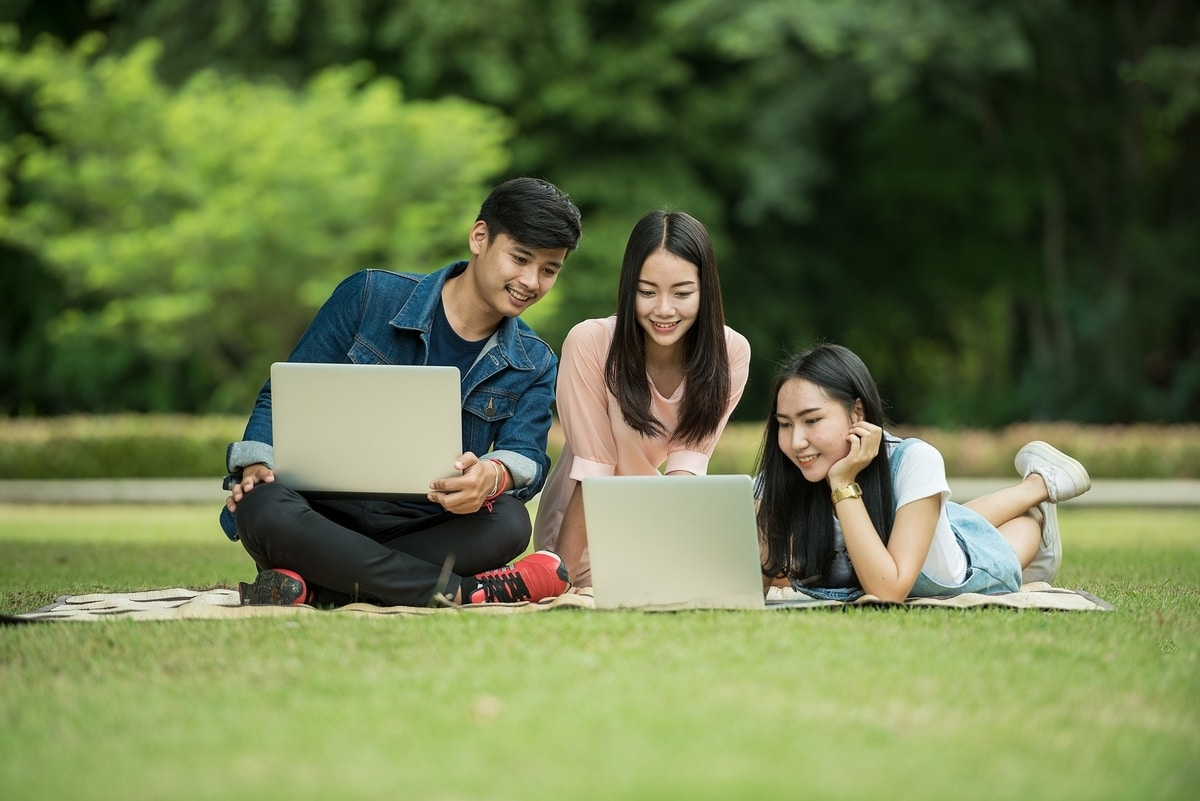 College students talking on grass abroad