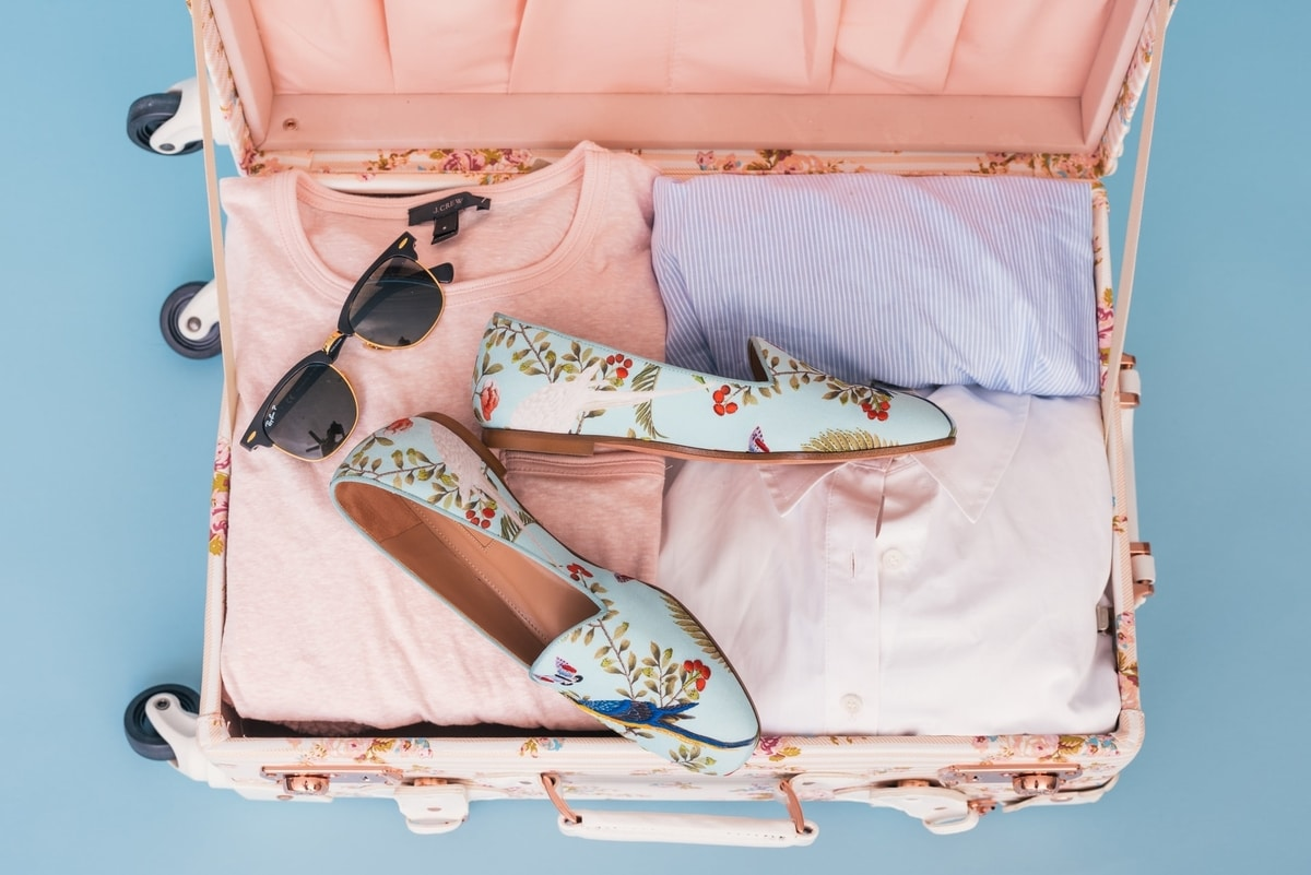 open-pink-suitcase-of-clothes