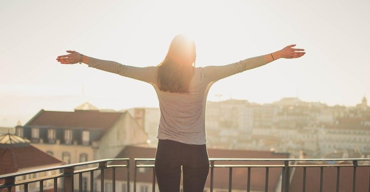lady on balcany feeling sunshine