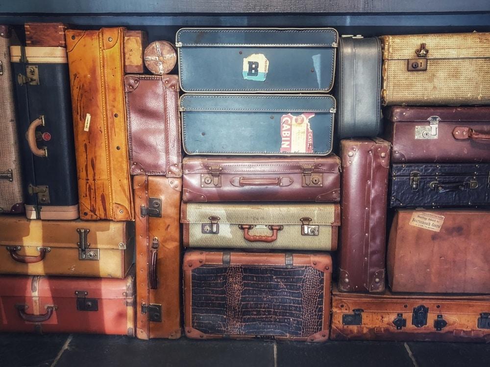 Suitcases stacked on one another